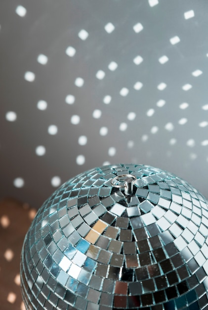 Big disco ball with bright party lights Free Photo