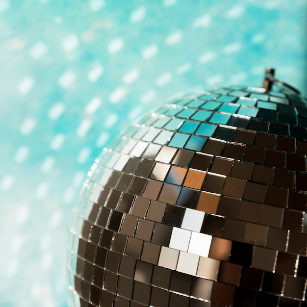 Big disco ball with party lights Free Photo