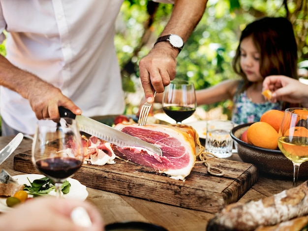 Big family having dinner at the veranda Premium Photo