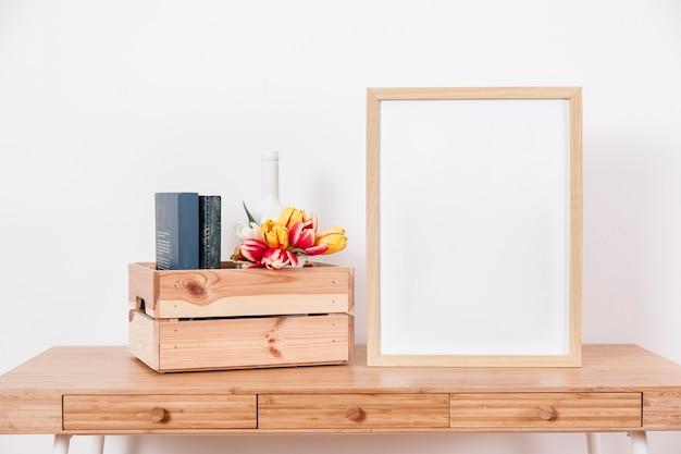 Big frame near box Free Photo