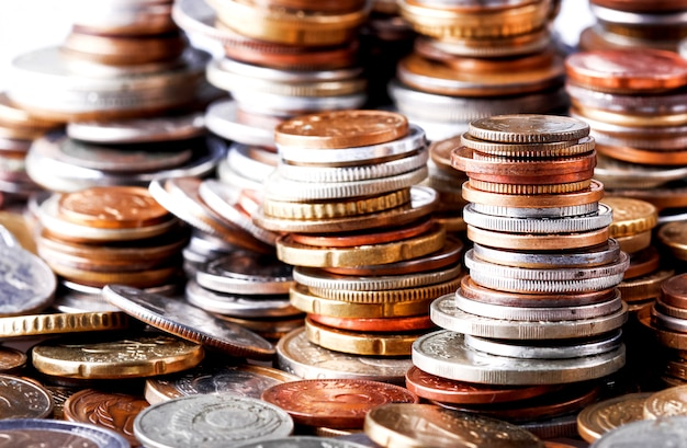 Big Heap Of Columns Of Different Coins On White Background