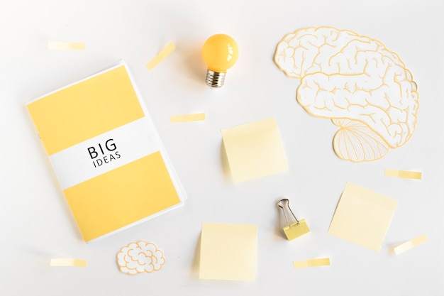 Big ideas diary, light bulb, brain and stationeries on white background Free Photo