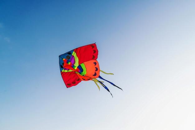 Big red kite in clear blue sky Premium Photo