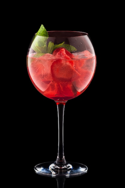 Big round wine glass with fresh cold lemonade isolated on black background Premium Photo
