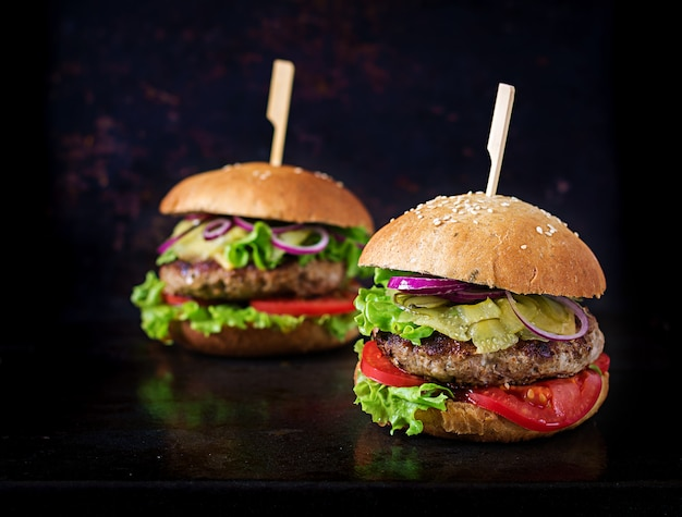 Big sandwich - hamburger burger with beef,  tomato, cheese and pickled cucumber. Premium Photo