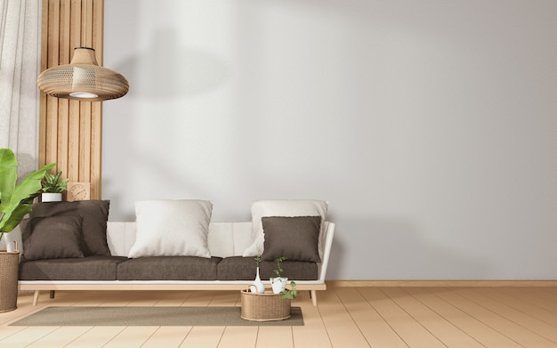 Big sofa in a spacious room tropical interior with sofa and plants decoration on wooden floor.3d rendering Premium Photo
