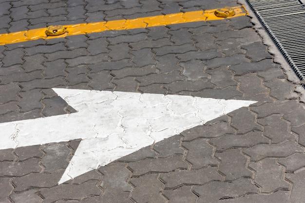 Big white arrow on the street Free Photo