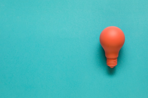 Bight orange colored light bulb Free Photo