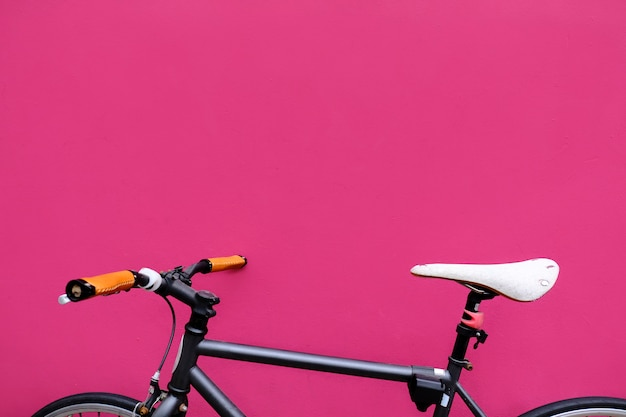Bike by a fuchsia wall Free Photo