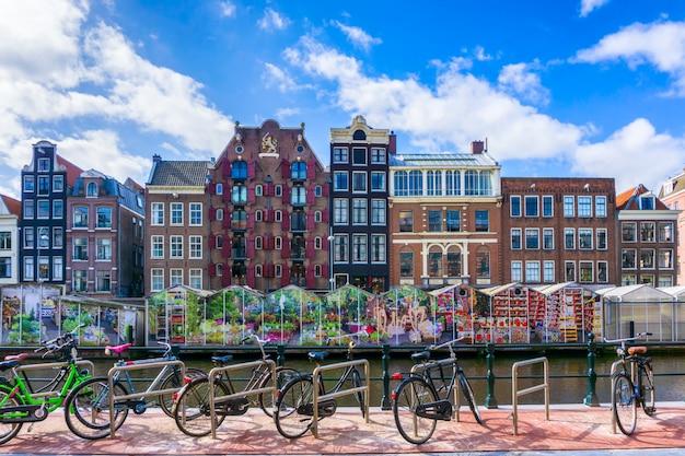 Bike over canal amsterdam city Premium Photo