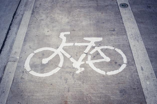 Bike Lane Symbol Bicycle White Sign On Concrete Road Photo