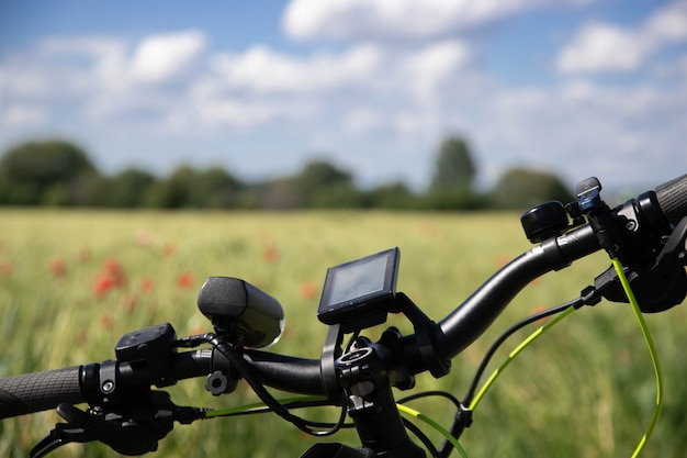 Bike with navigation device. spring field with red poppies. Premium Photo