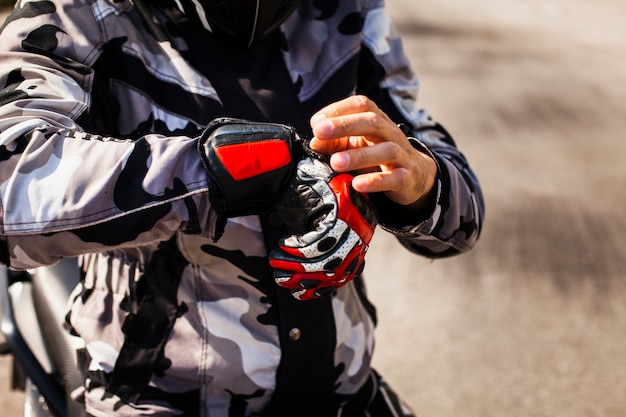 Biker checking his gear before ride Free Photo
