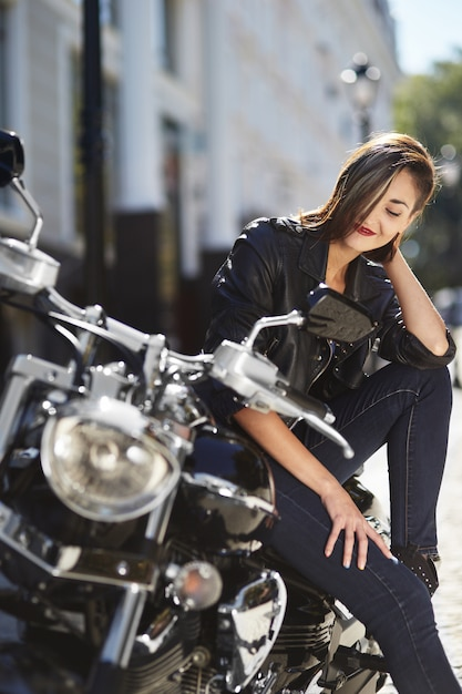 Free Photo | Biker girl in a leather jacket on a motorcycle