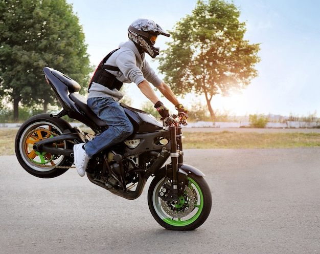 Biker riding motorcycle Free Photo
