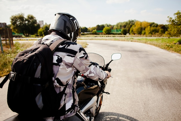 Biker riding on the road carefully Free Photo