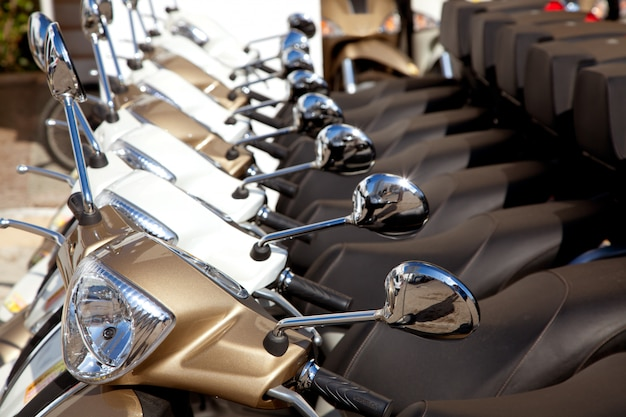 Bikes scooter motoerbikes detail in a row Premium Photo