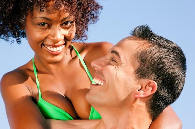 Bikini girl with boyfriend Premium Photo
