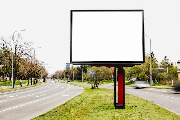 Billboard blank for outdoor advertising in the middle of the road Free Photo