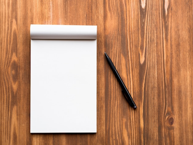 Billboard with blank sheet for notes and pencil in abstract blank wooden background Premium Photo