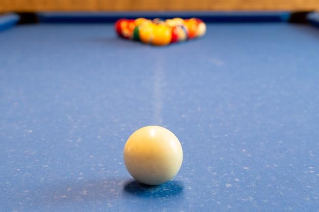 Billiard balls on the snooker table selected focus. Premium Photo