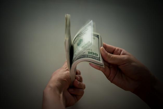 Billie dollar in hand Free Photo
