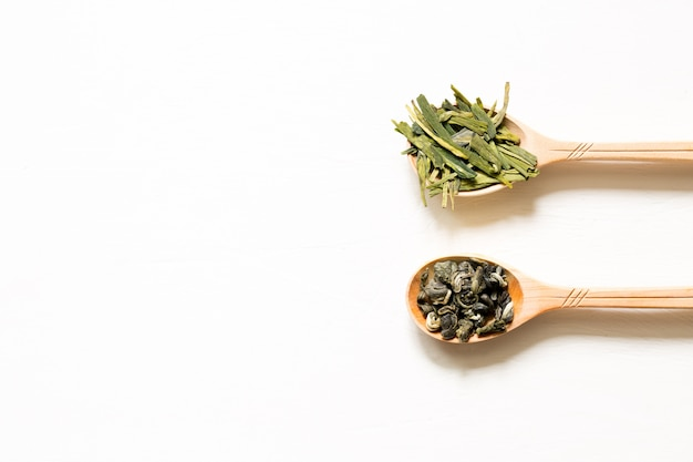 Biluochun and longjing. chinese leaf green tea in a spoon on a white background. Premium Photo