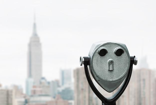 Binoculars and new york city manhattan skyline Premium Photo