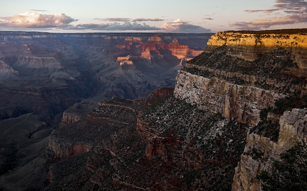 Bird'-eye shot of the beautiful grand canyon with red, brown and grey rocky mountains Free Photo