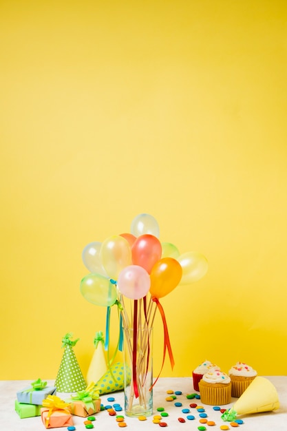 Birthday arrangement with colorful balloons Free Photo