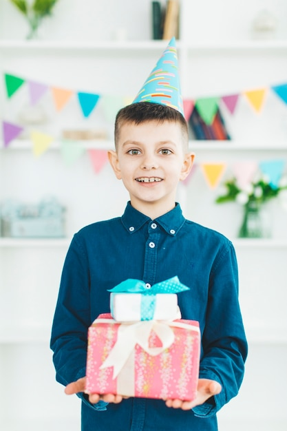 Birthday boy with gifts Free Photo