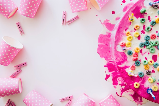 Birthday cake and frame from party stuff Photo | Free Download