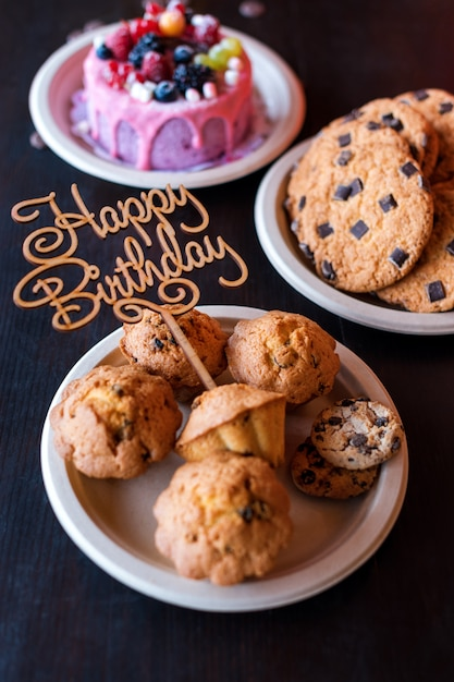 Fabulous Birthday Cake And Muffins With Wooden Greeting Sign On Rustic Wall Funny Birthday Cards Online Eattedamsfinfo