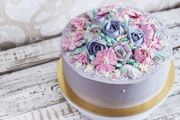 Birthday cake with flowers rose on white background Premium Photo