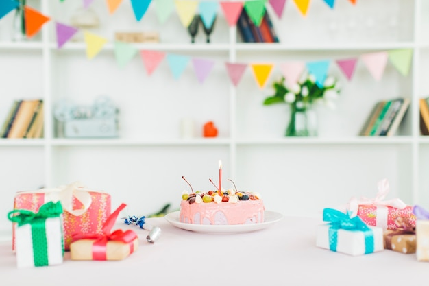 Birthday cake with gifts Free Photo