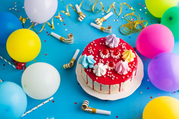 Birthday cake with party whistles Free Photo