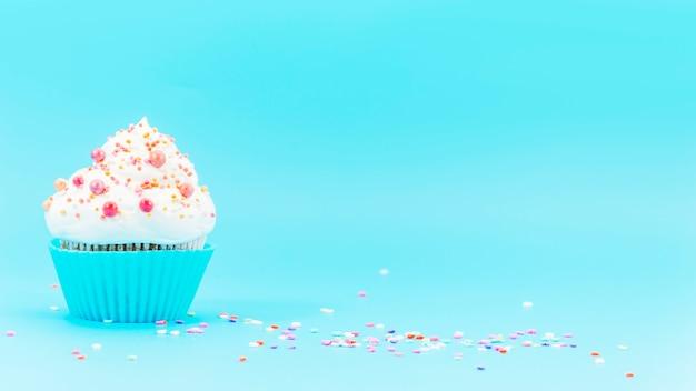 Birthday cupcake with confetti Free Photo