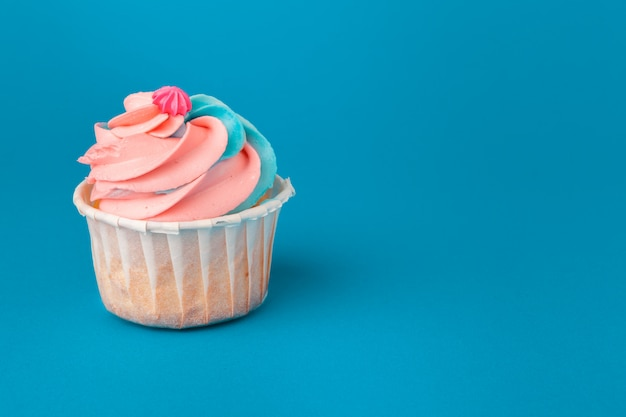 Birthday cupcakes on blue close up Premium Photo