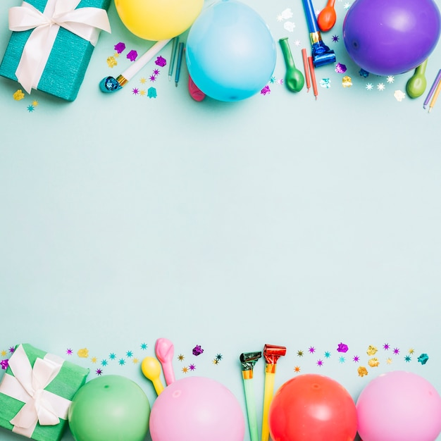 Birthday decoration card on blue background Free Photo