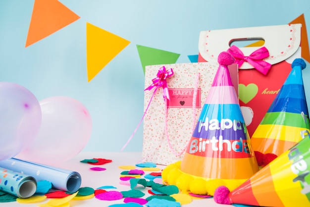 Birthday Decorations With Shopping Bag On Blue Background Free Photo