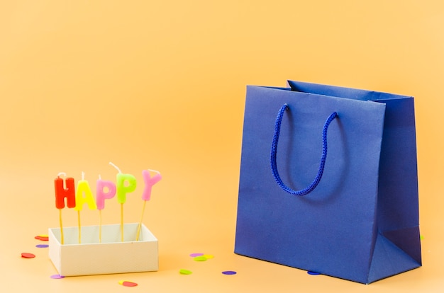 Birthday gift bag with candles Free Photo