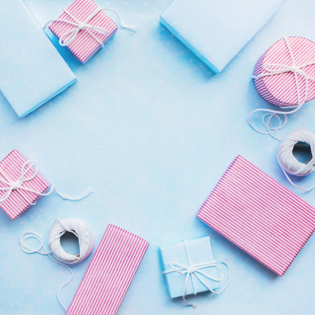 Birthday gifts. festive pink blue box with cord Premium Photo