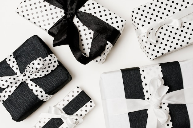 Birthday gifts presents box wrapped with white and black beautiful polka dots paper Free Photo