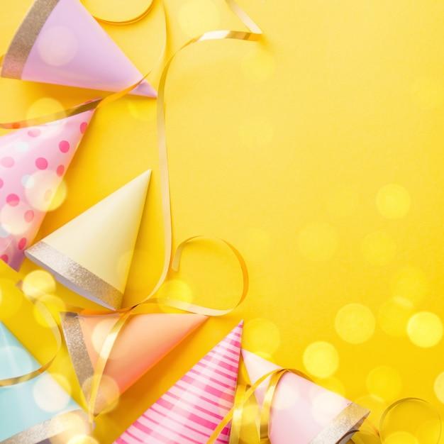 Birthday party background on yellow Premium Photo