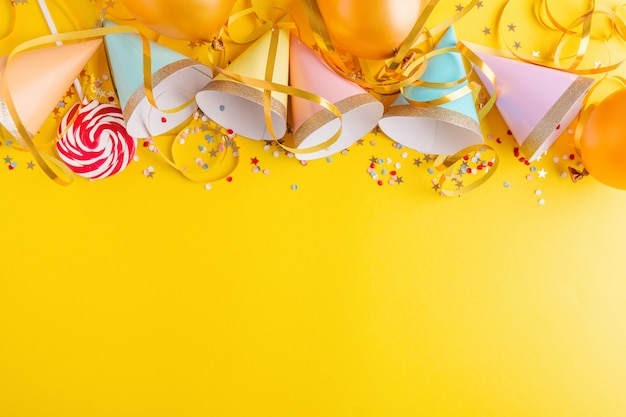 Birthday party background on yellow Premium Photo