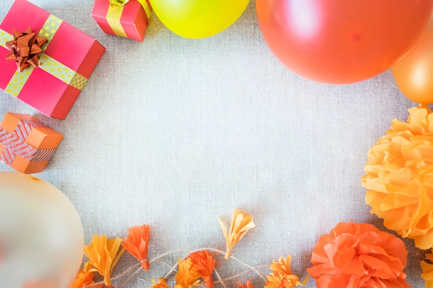 Birthday party frame background with festive decor, ribbons, gift boxes, balloons, garland Premium Photo