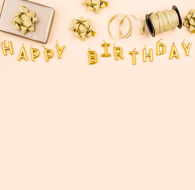 Birthday ribbons with present top view Premium Photo