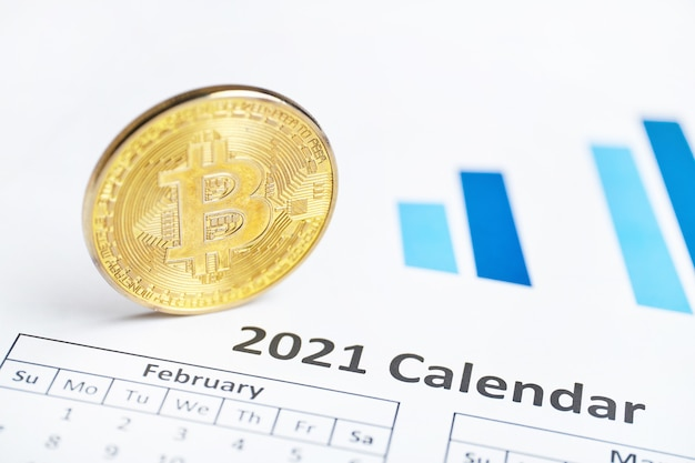 Bitcoin cryptocurrency concept on the calendar Premium Photo