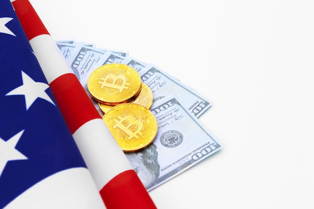 Bitcoin physical coins on american flag with dollars Premium Photo