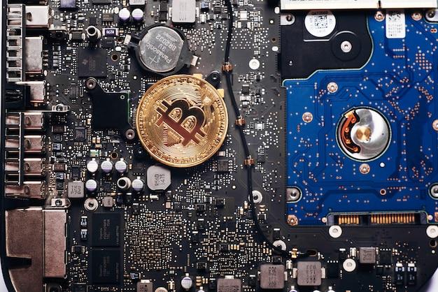 Bitcoin on a processor Premium Photo
